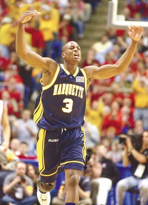 Dwyane Wade celebrates a teammate's three-pointer in Marquette's 2003 victory over Pittsburgh.