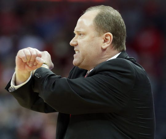 Wisconsin head coach Greg Gard wears an intense look on his face as he gestures during the second half of his team's game against Michigan on  Saturday.