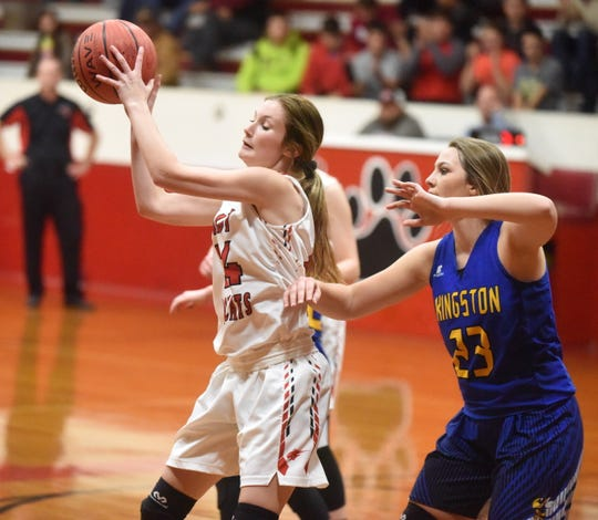 Flippin's Emily Davenport catches a pass during a recent game against Kingston. Davenport scored 28 points in the Lady Bobcats' upset victory over Cotter on Friday night.