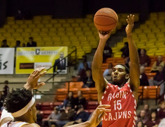 University of Louisiana at Lafayette's P.J. Hardy (15) shoots a three-point basket during the game against University of Louisiana at Monroe at Fant-Ewing Coliseum in Monroe, La. on Jan. 19.