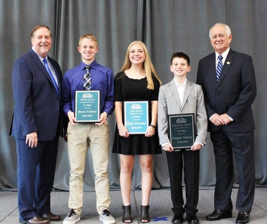 Ouachita Parish Schools Superintendent Don Coker (far left) and School Board President Jerry Hicks (far right) stand with this year's Students of the Year (from left)  Bryce Folmar of West Ridge Middle School, Gray Grunsky of Sterlington High School and Cooper Nelson of Sterlington Elementary School