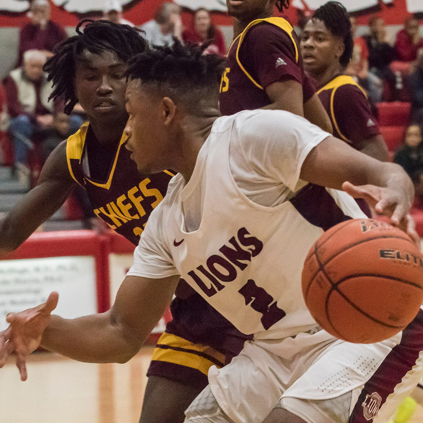 Ouachita's Paul King (2) makes a drive to the net while Natchitoches Central's Nathan Curtis (10) attempts to defend during the game at Ouachita High School in Monroe, La. on Jan 18.