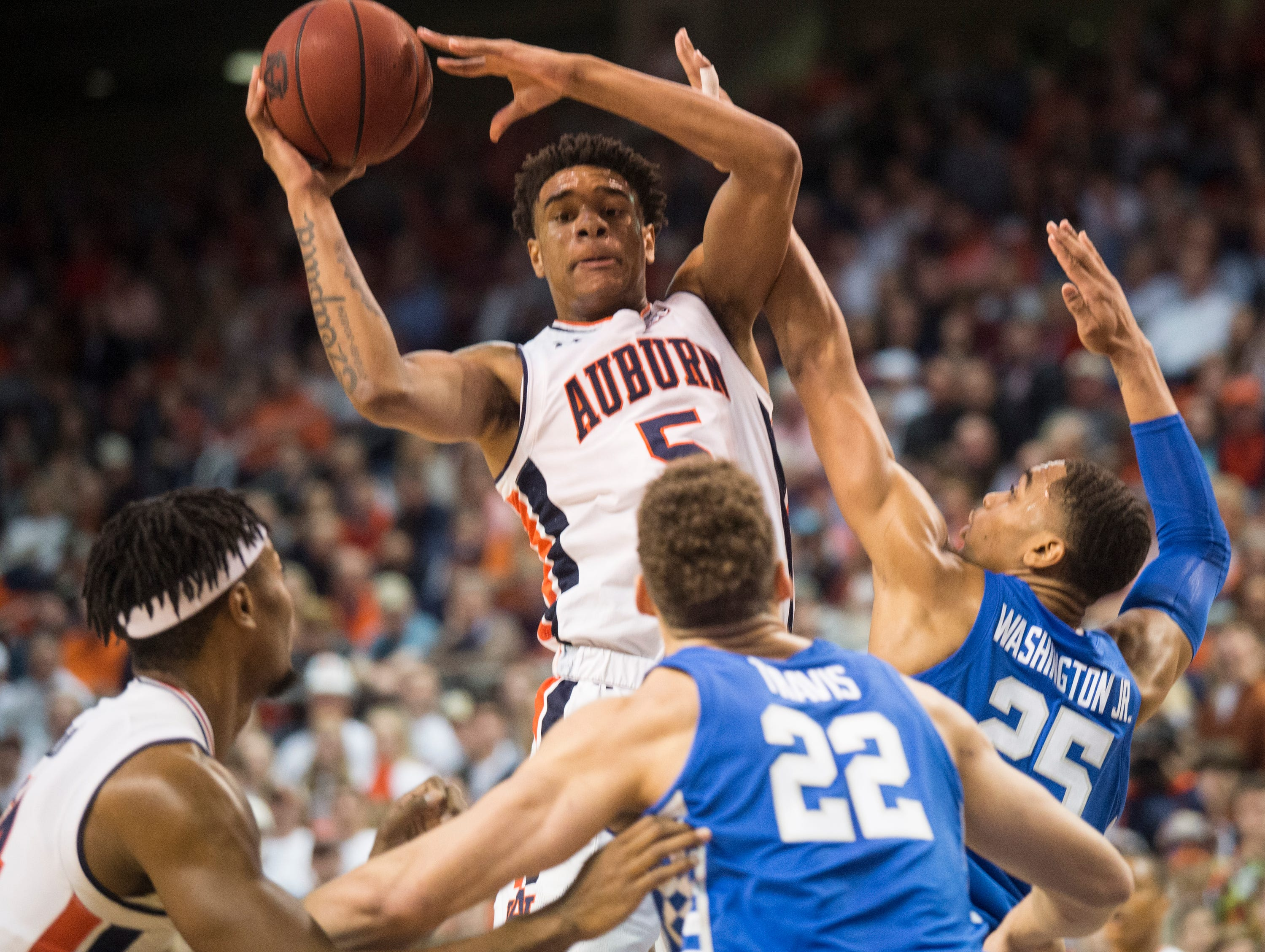 Auburn forward Chuma Okeke (5) looks to pass out of a layup at Auburn Arena in Auburn, Ala., on Saturday, Jan. 19, 2019. Kentucky leads Auburn 35-27 at halftime.