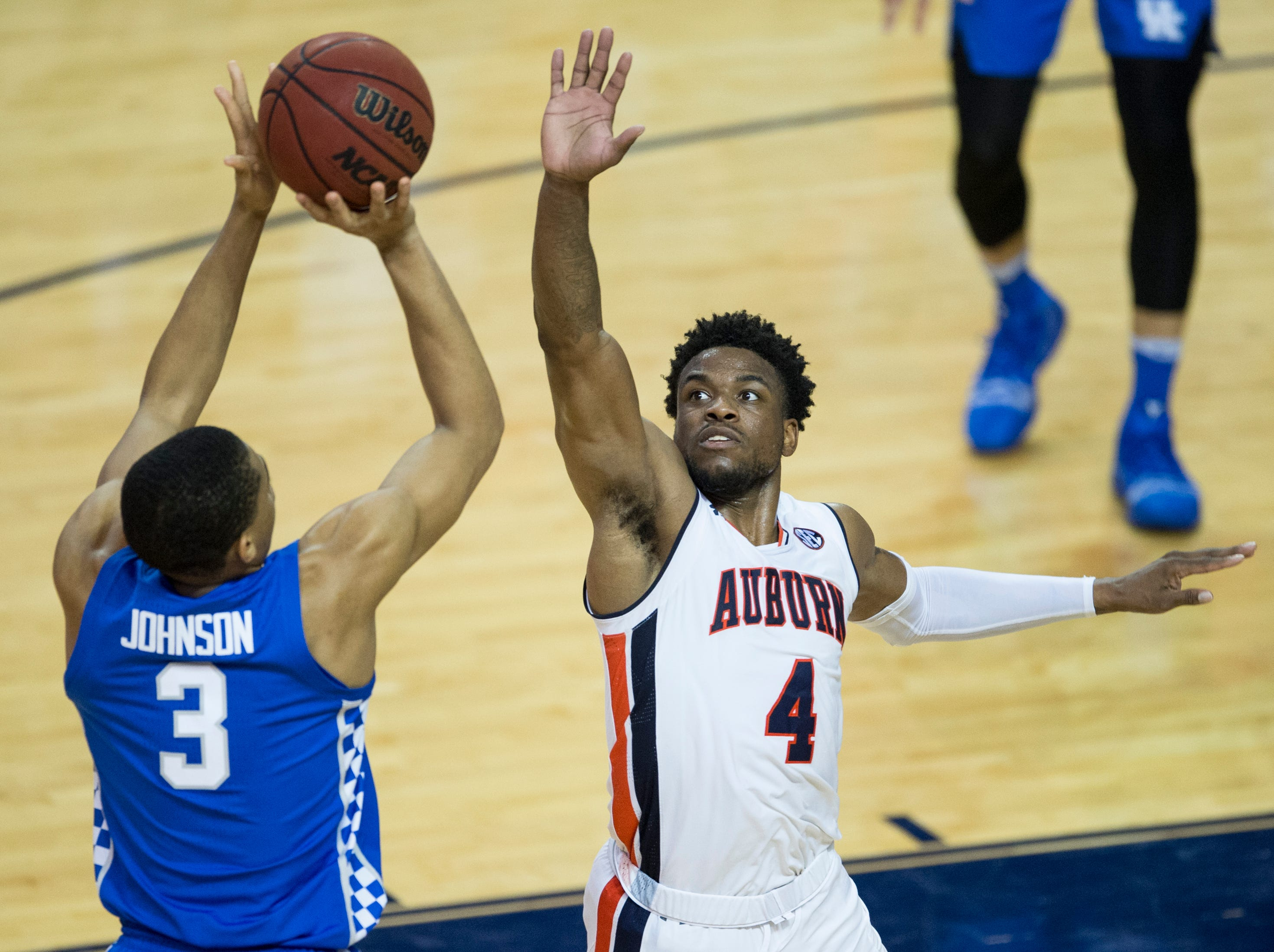 Auburn forward Danjel Purifoy (3) takes a three pointer over Auburn guard Malik Dunbar (4) at Auburn Arena in Auburn, Ala., on Saturday, Jan. 19, 2019. Kentucky defeats Auburn 82-80.