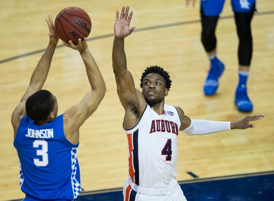 Kentucky guard Keldon Johnson (3) takes a three pointer over Auburn guard Malik Dunbar (4) at Auburn Arena in Auburn, Ala., on Saturday, Jan. 19, 2019. Kentucky defeated Auburn 82-80.