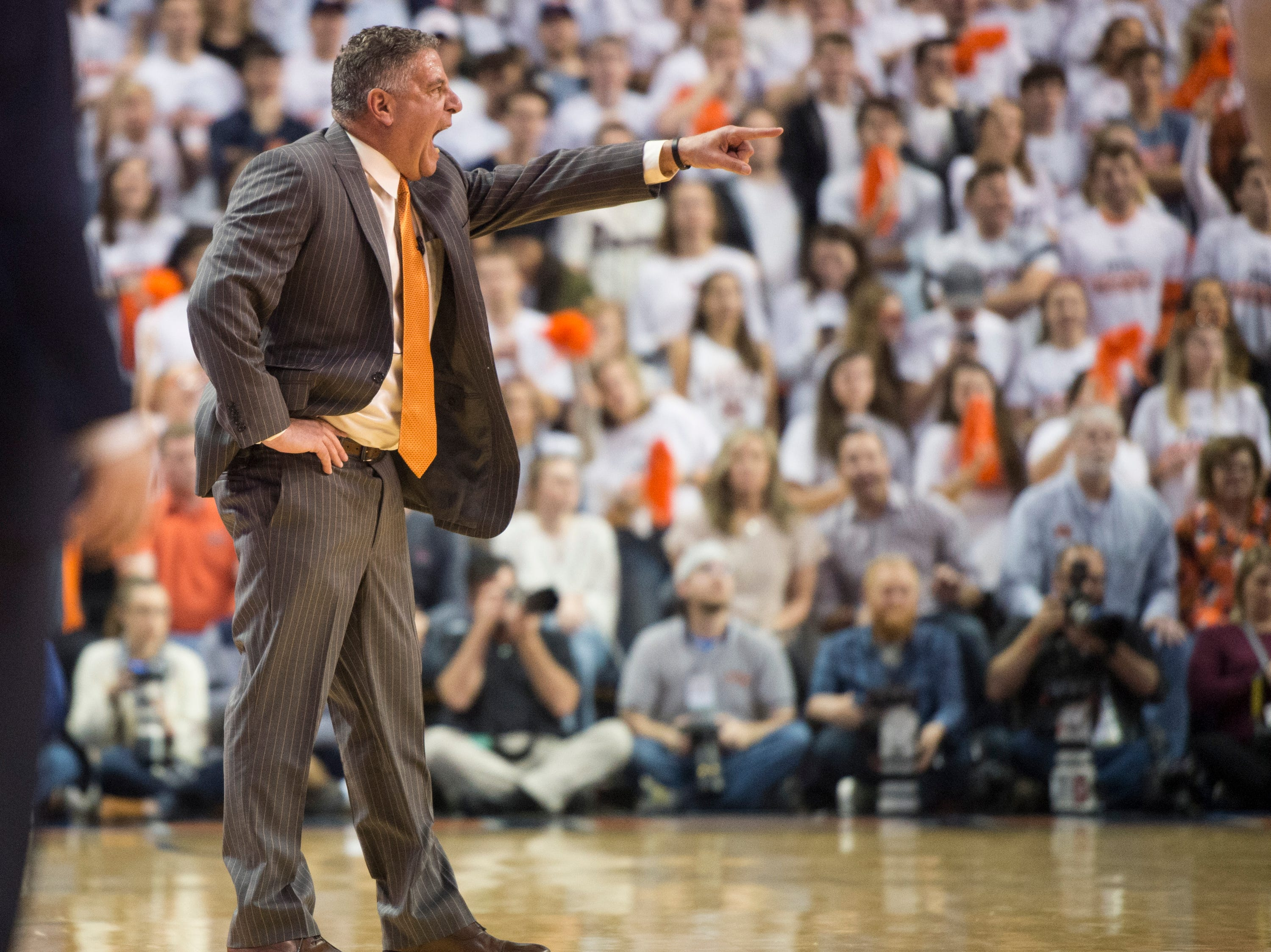 Auburn head coach Bruce Pearl yells at his team from the bench at Auburn Arena in Auburn, Ala., on Saturday, Jan. 19, 2019. Kentucky leads Auburn 35-27 at halftime.