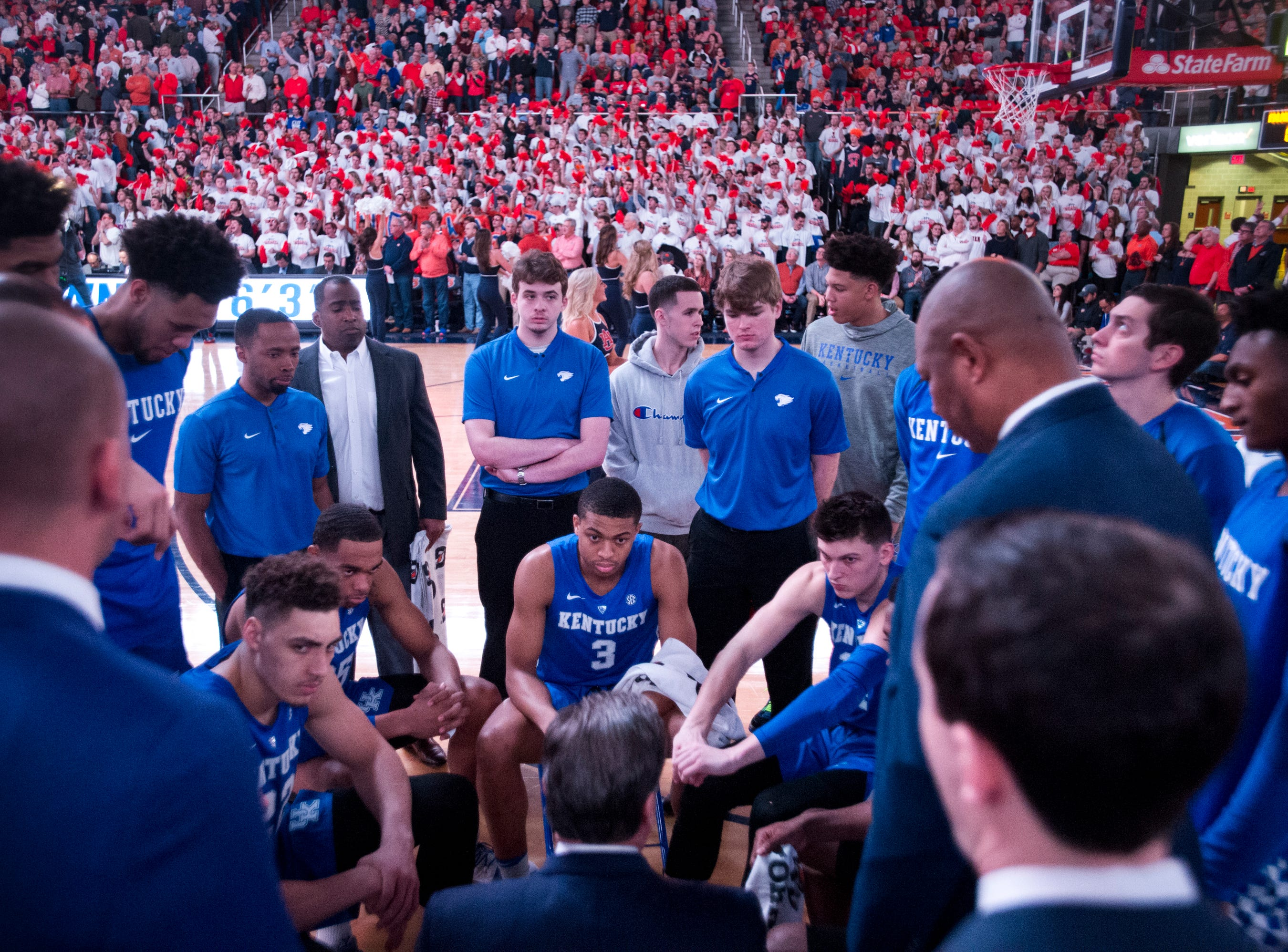 Kentucky head coach John Calipari huddles with his team before the game at Auburn Arena in Auburn, Ala., on Saturday, Jan. 19, 2019. Kentucky leads Auburn 35-27 at halftime.