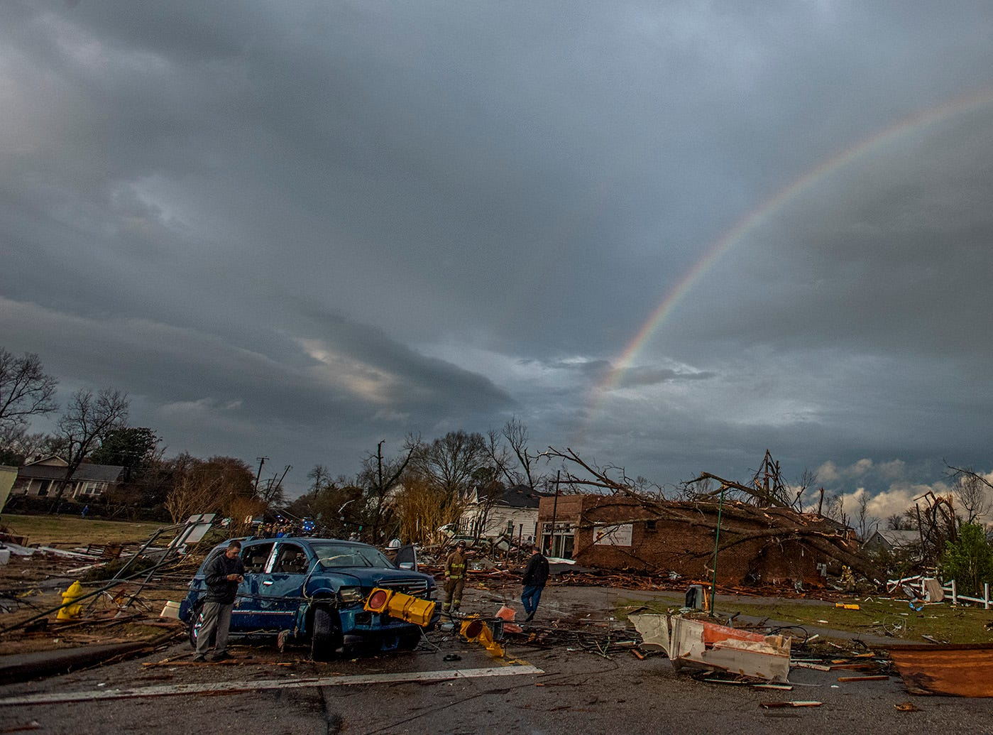 A rainbow over damage from a tornado touchdown in Wetumpka, Ala., on Saturday afternoon January 19, 2019.