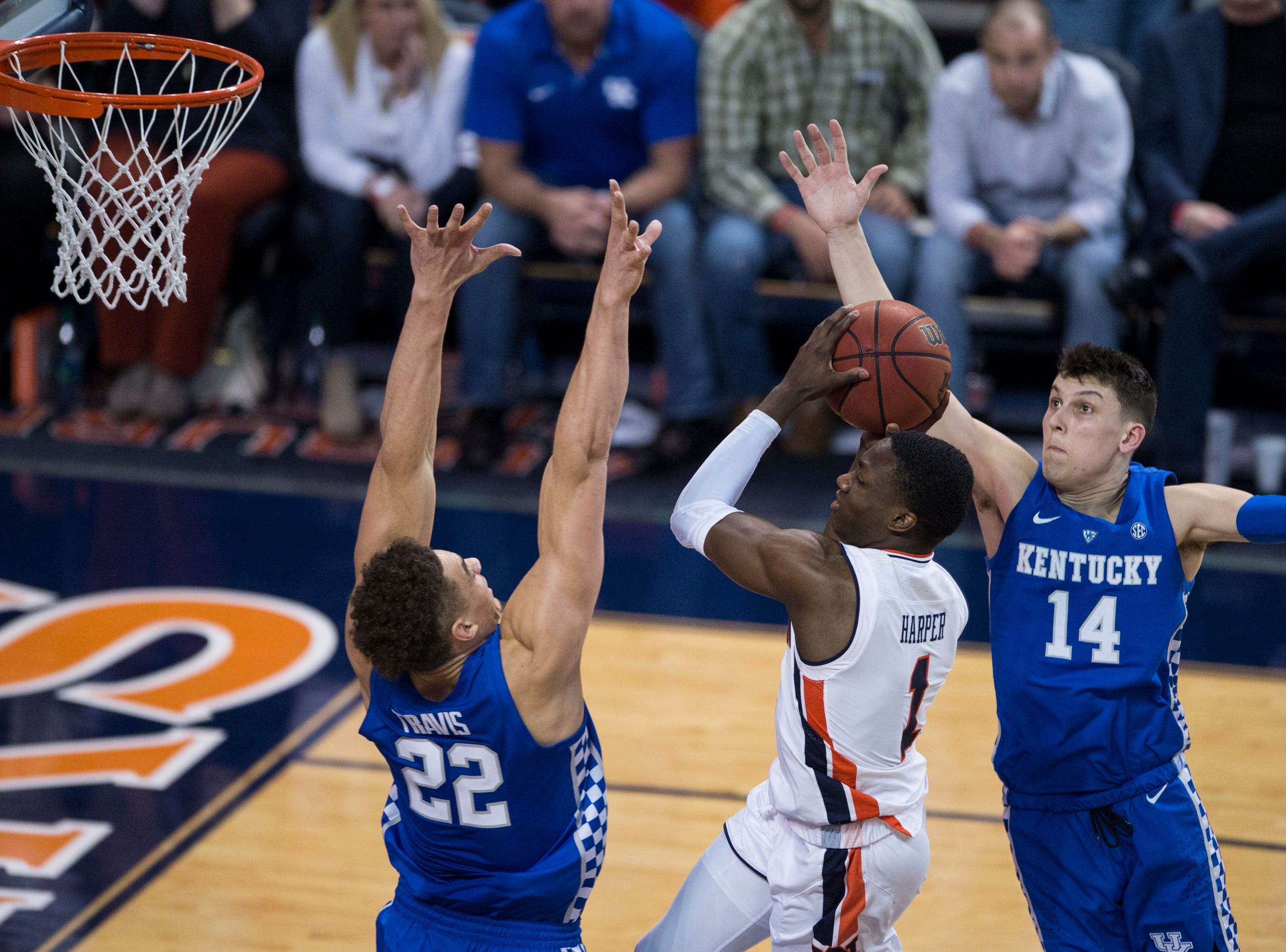 Auburn guard Jared Harper (1) goes up for a layup over Kentucky forward Reid Travis (22) at Auburn Arena in Auburn, Ala., on Saturday, Jan. 19, 2019. Kentucky defeats Auburn 82-80.