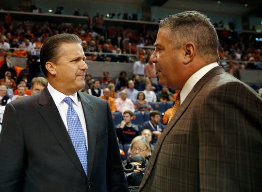 Kentucky head coach John Calipari, left, and Auburn head coach Bruce Pearl meet before an NCAA college basketball game, Saturday, Jan. 16, 2016, in Auburn, Ala. Auburn won 75-70.