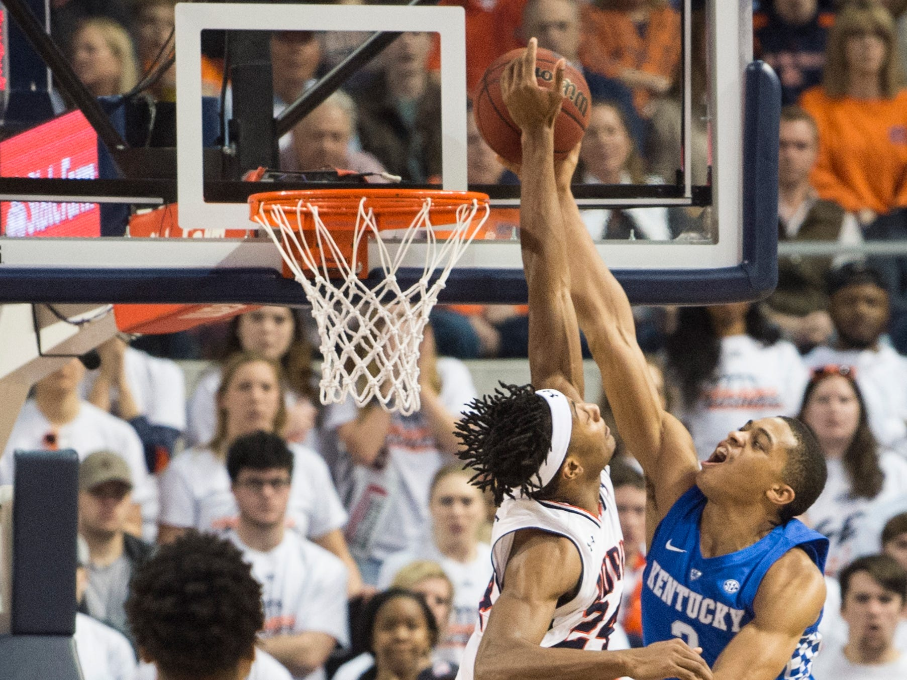 Auburn forward Anfernee McLemore (24) blocks Kentucky guard Keldon Johnson (3) at Auburn Arena in Auburn, Ala., on Saturday, Jan. 19, 2019. The ball went in after the block for a Kentucky bucket. Kentucky leads Auburn 35-27 at halftime.