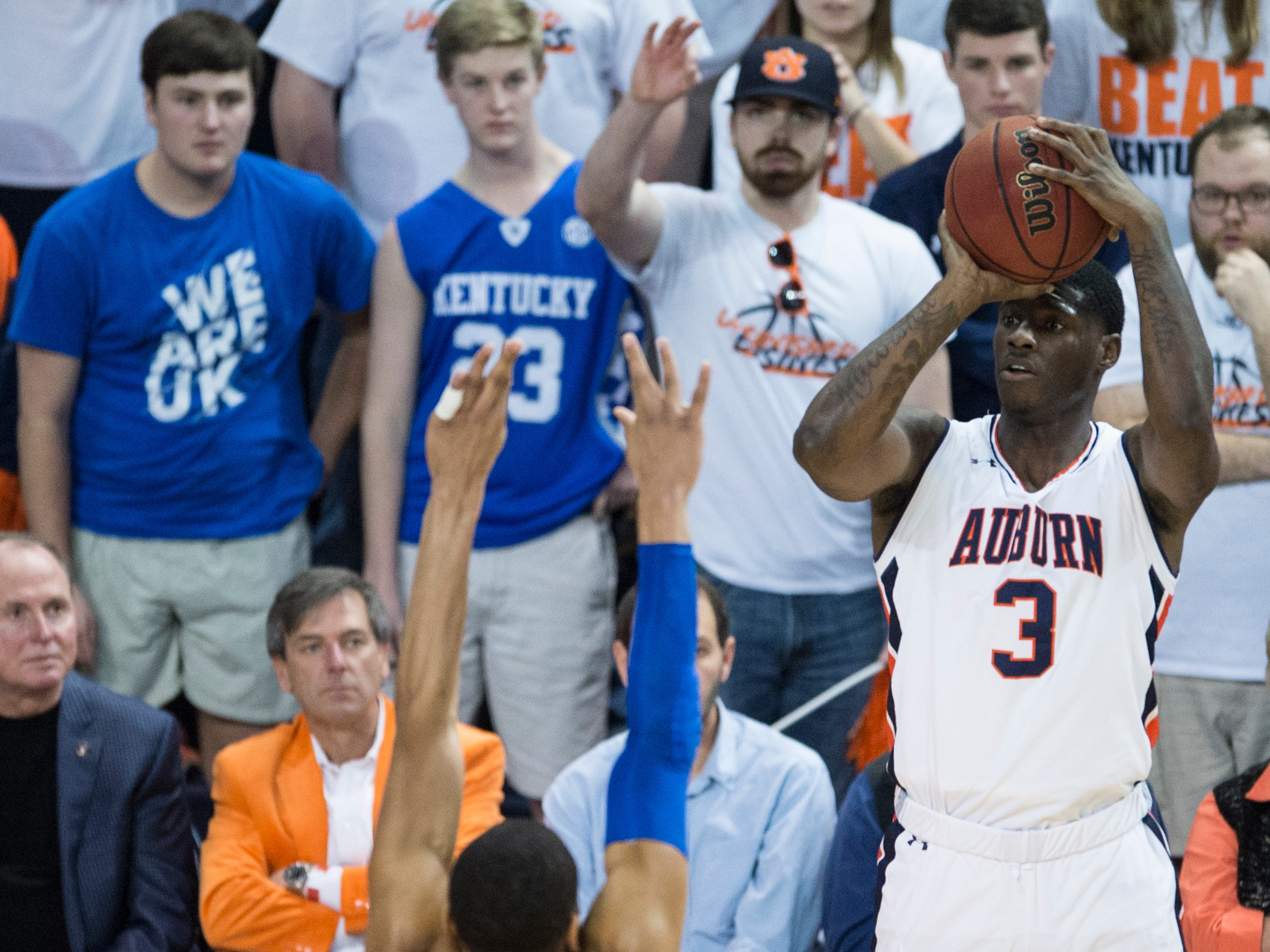 Auburn forward Danjel Purifoy (3) takes a three pointer over Kentucky forward PJ Washington (25) at Auburn Arena in Auburn, Ala., on Saturday, Jan. 19, 2019. Kentucky defeated Auburn 82-80.