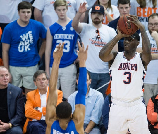 Auburn forward Danjel Purifoy (3) takes a three pointer over Kentucky forward PJ Washington (25) at Auburn Arena in Auburn, Ala., on Saturday, Jan. 19, 2019. Kentucky defeated Auburn 82-80.