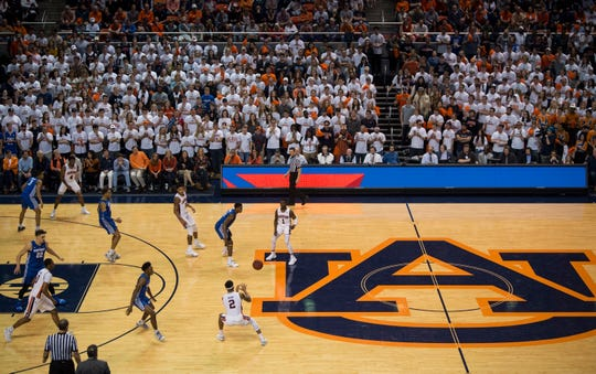 Auburn guard Jared Harper (1) passes the ball to guard Bryce Brown (2) as they take on Kentucky at Auburn Arena in Auburn, Ala., on Saturday, Jan. 19, 2019.