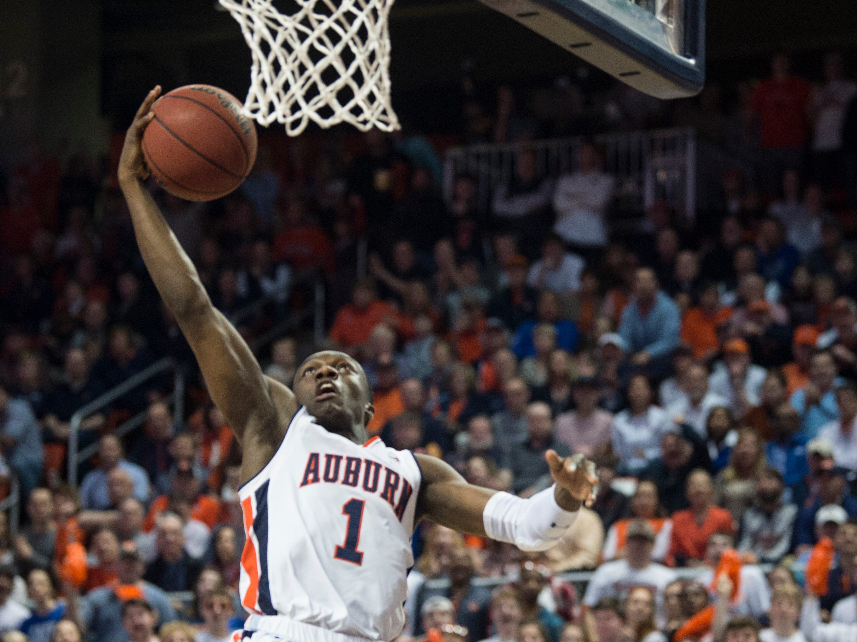 Auburn guard Jared Harper (1) goes up for a layup at Auburn Arena in Auburn, Ala., on Saturday, Jan. 19, 2019. Kentucky leads Auburn 35-27 at halftime.
