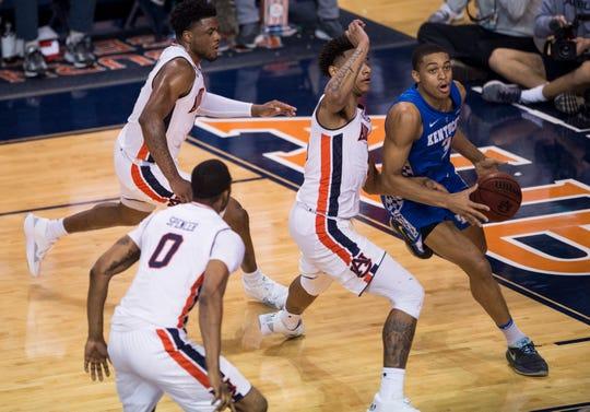 Auburn defends Kentucky guard Keldon Johnson (3) as he drives the baseline at Auburn Arena in Auburn, Ala., on Saturday, Jan. 19, 2019. Kentucky defeated Auburn 82-80.
