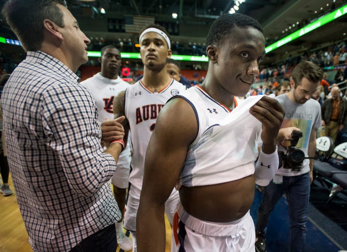Auburn guard Jared Harper (1) reacts to the lose as he walks off the court after the game at Auburn Arena in Auburn, Ala., on Saturday, Jan. 19, 2019. Kentucky defeats Auburn 82-80.