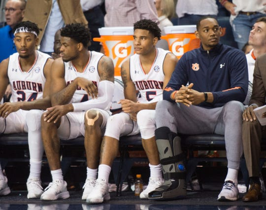 Auburn center Austin Wiley, right, sits on the bench with an lower leg injury at Auburn Arena in Auburn, Ala., on Saturday, Jan. 19, 2019.