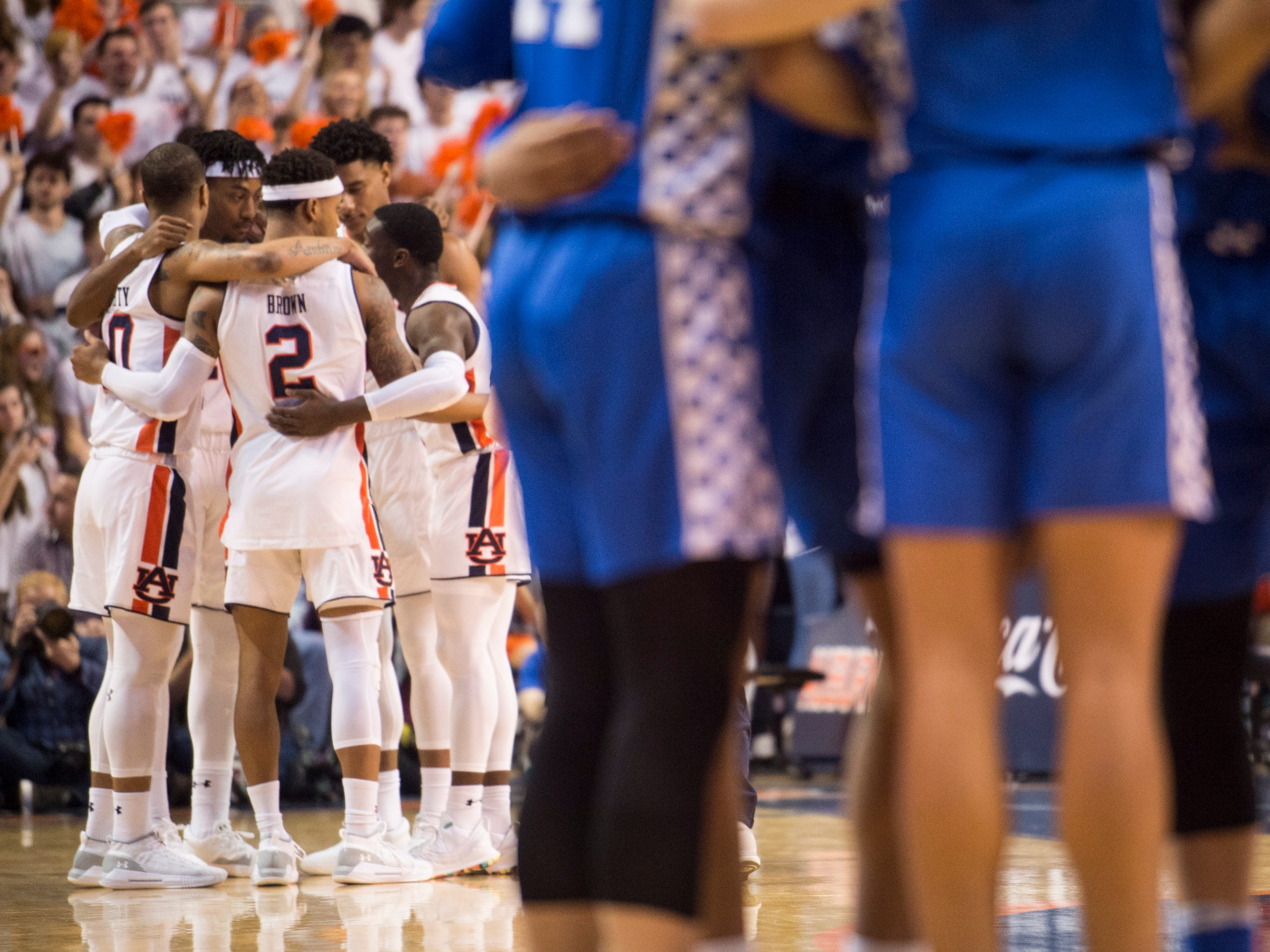 Auburn's team huddles up before they take on Kentucky at Auburn Arena in Auburn, Ala., on Saturday, Jan. 19, 2019. Kentucky leads Auburn 35-27 at halftime.