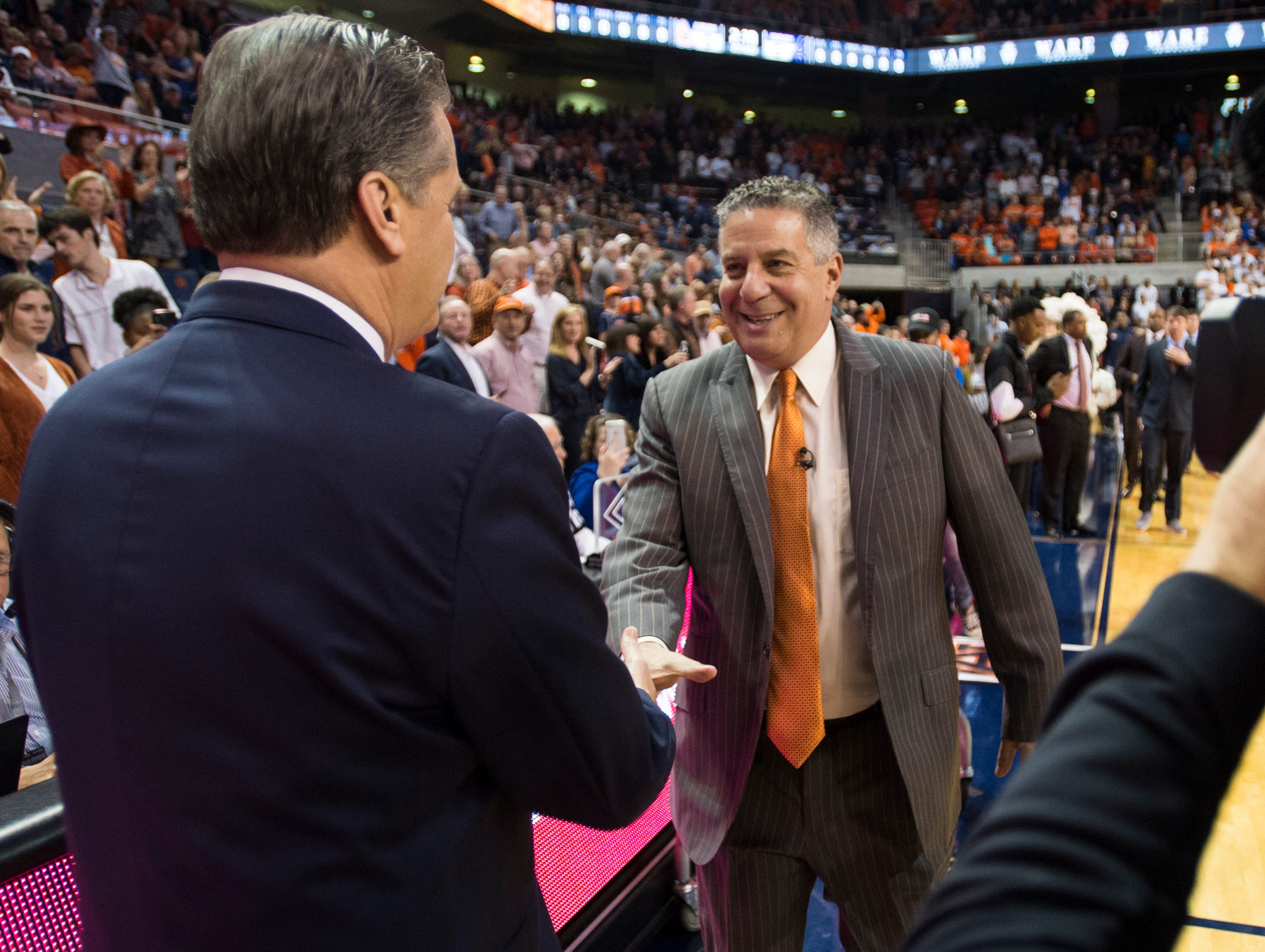 Kentucky head coach John Calipari, left, and Auburn head coach Bruce Pearl meet before the game at Auburn Arena in Auburn, Ala., on Saturday, Jan. 19, 2019. Kentucky leads Auburn 35-27 at halftime.
