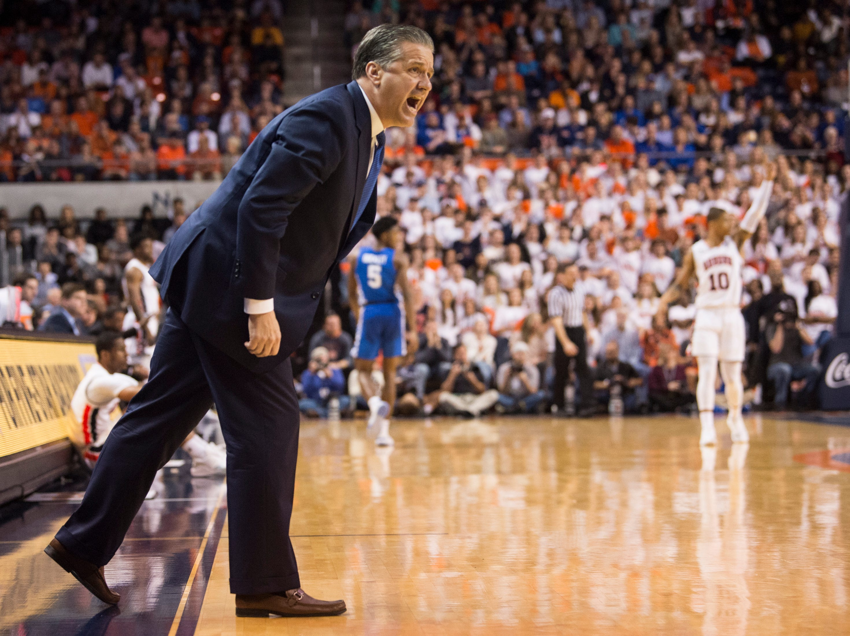 Kentucky head coach John Calipari yells at his team from the bench at Auburn Arena in Auburn, Ala., on Saturday, Jan. 19, 2019. Kentucky leads Auburn 35-27 at halftime.