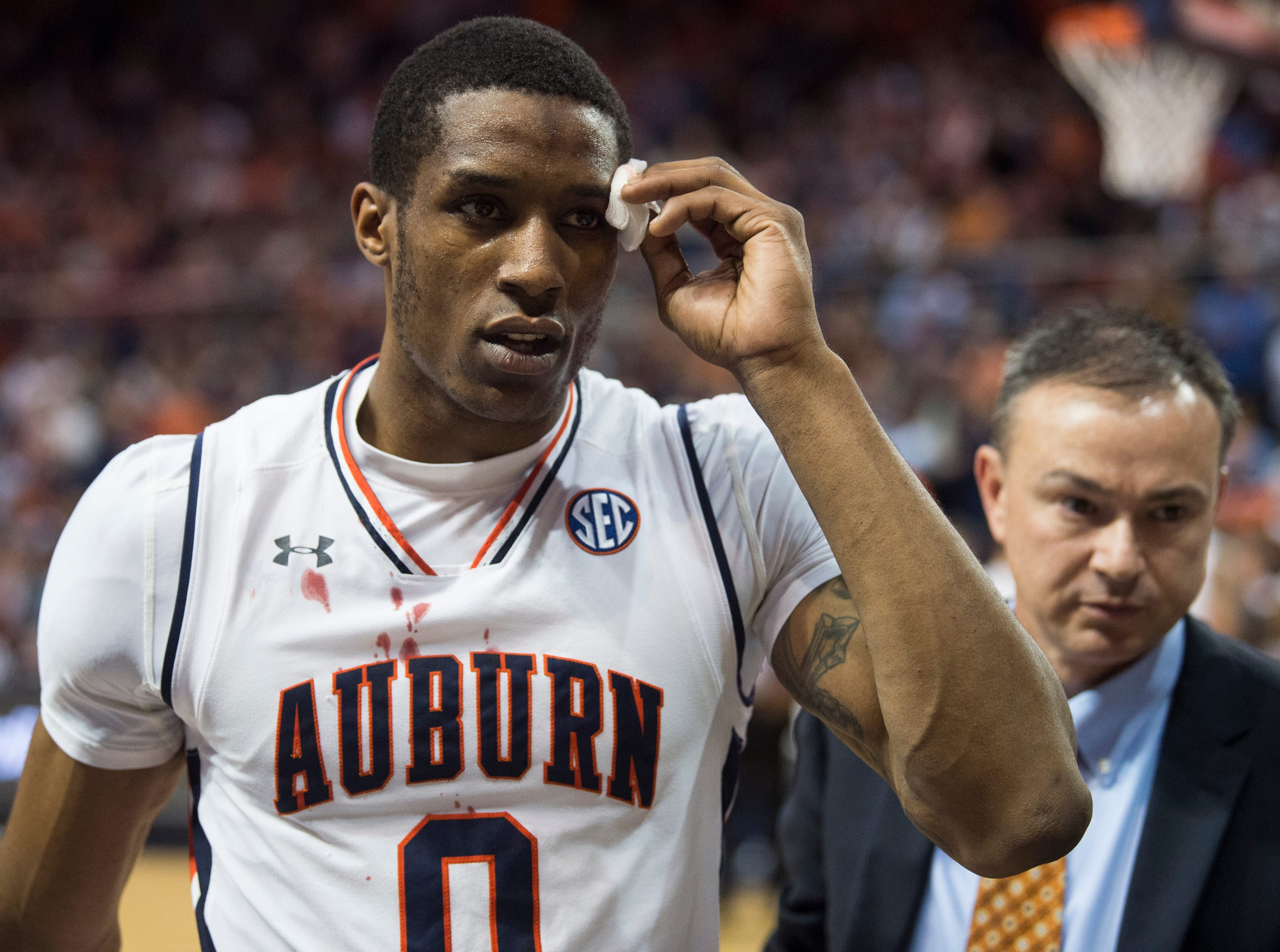 Auburn forward Horace Spencer (0) heads to the locker room with a head injury at Auburn Arena in Auburn, Ala., on Saturday, Jan. 19, 2019. Kentucky defeated Auburn 82-80.