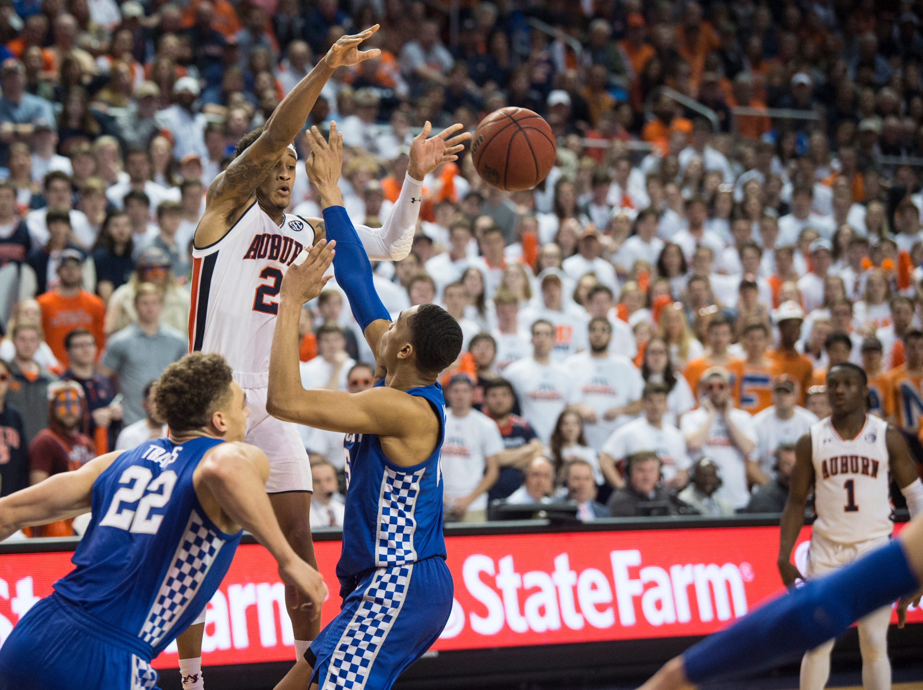 Auburn guard Bryce Brown (2) passes the ball down low at Auburn Arena in Auburn, Ala., on Saturday, Jan. 19, 2019. Kentucky defeats Auburn 82-80.