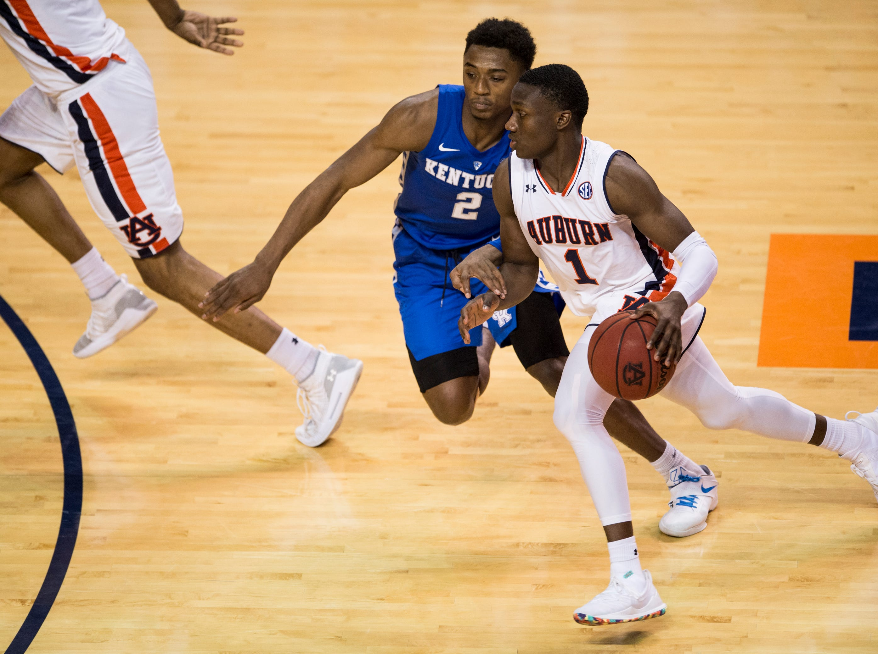 Auburn guard Jared Harper (1) drives to the basket on Kentucky guard Ashton Hagans (2) at Auburn Arena in Auburn, Ala., on Saturday, Jan. 19, 2019. Kentucky defeats Auburn 82-80.