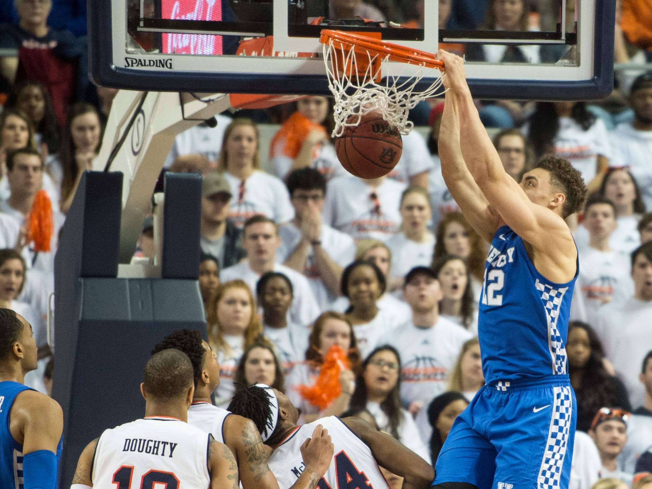 Kentucky forward Reid Travis (22) tip slams the ball at Auburn Arena in Auburn, Ala., on Saturday, Jan. 19, 2019. Kentucky leads Auburn 35-27 at halftime.