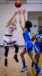 Prattville Christian's Ella Jane Connell (2) passes over Booker T. Washington Magnet's Madisson Dixon (1) on the PCA campus in Prattville, Ala., on Friday January 18, 2019.