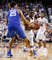 Auburn guard Jared Harper drives as Kentucky forward PJ Washington defends during the second half of an NCAA college basketball game Wednesday, Feb. 14, 2018, in Auburn, Ala. Auburn won 76-66.