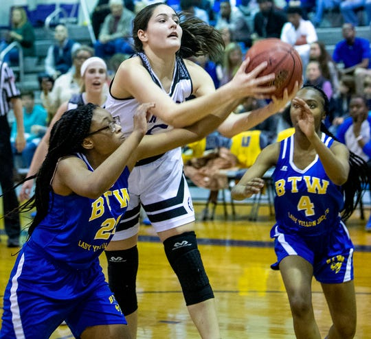 Prattville Christian's Tori DeMaio (5) grabs a rebound against Booker T. Washington Magnet on the PCA campus in Prattville, Ala., on Friday January 18, 2019.