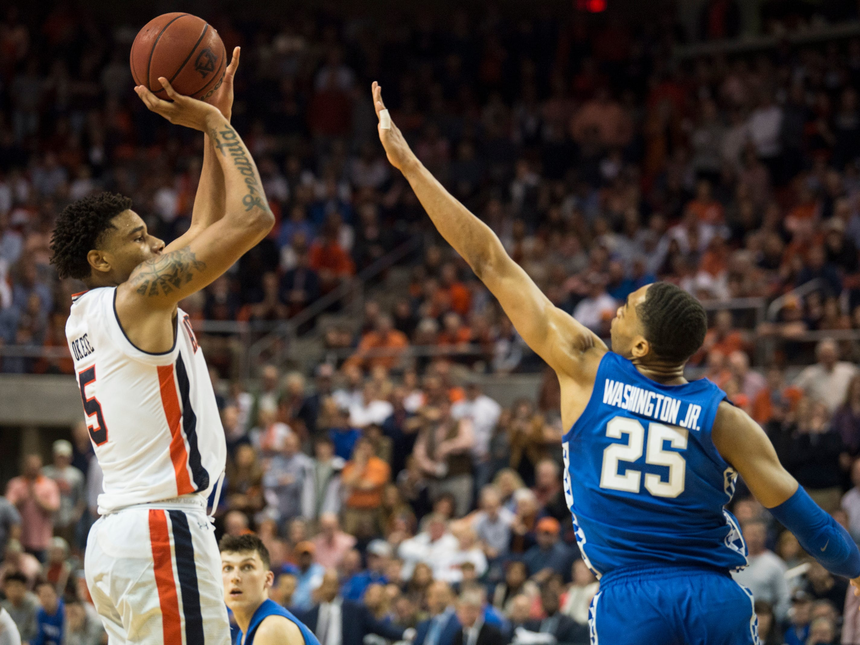Auburn forward Chuma Okeke (5) attempts a three pointer over Kentucky forward PJ Washington (25) at Auburn Arena in Auburn, Ala., on Saturday, Jan. 19, 2019. Kentucky defeats Auburn 82-80.