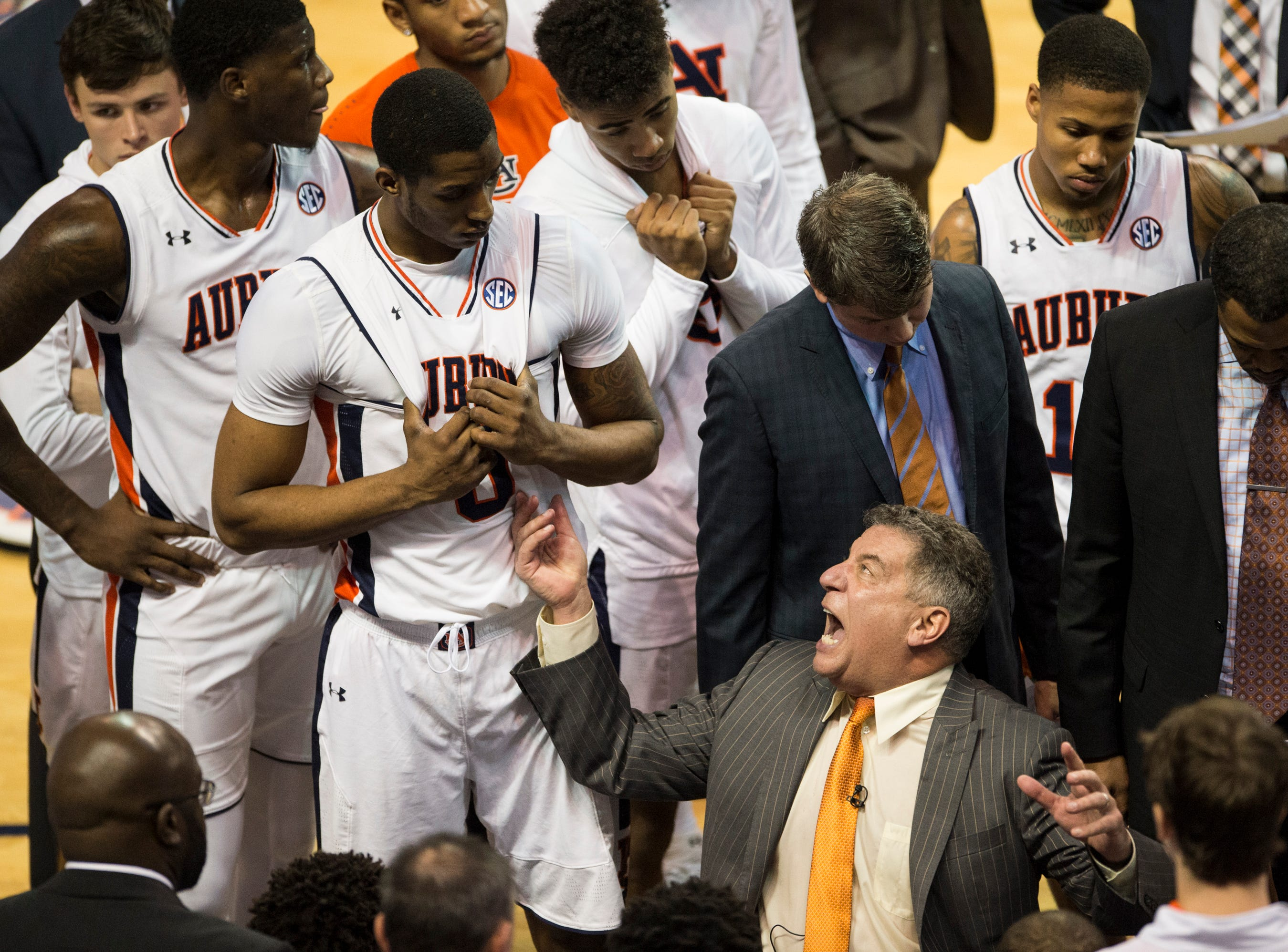 Auburn head coach Bruce Pearl talks with his team during a time out at Auburn Arena in Auburn, Ala., on Saturday, Jan. 19, 2019. Kentucky defeats Auburn 82-80.