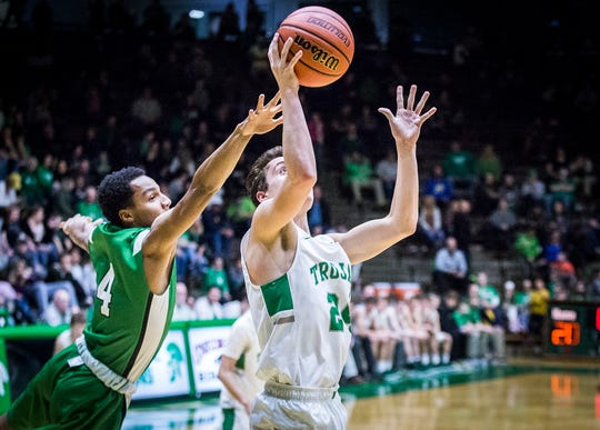 FILE -- Former New Castle player Nicholas Grieser slips past Yorktown's defense during their game at New Castle High School Friday, Jan. 18, 2019.