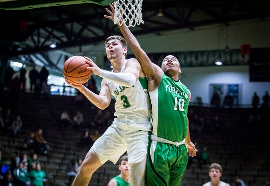 New Castle's Luke Bumbalough shoots past Yorktown's defense during their game at New Castle High School Friday, Jan. 18, 2019.
