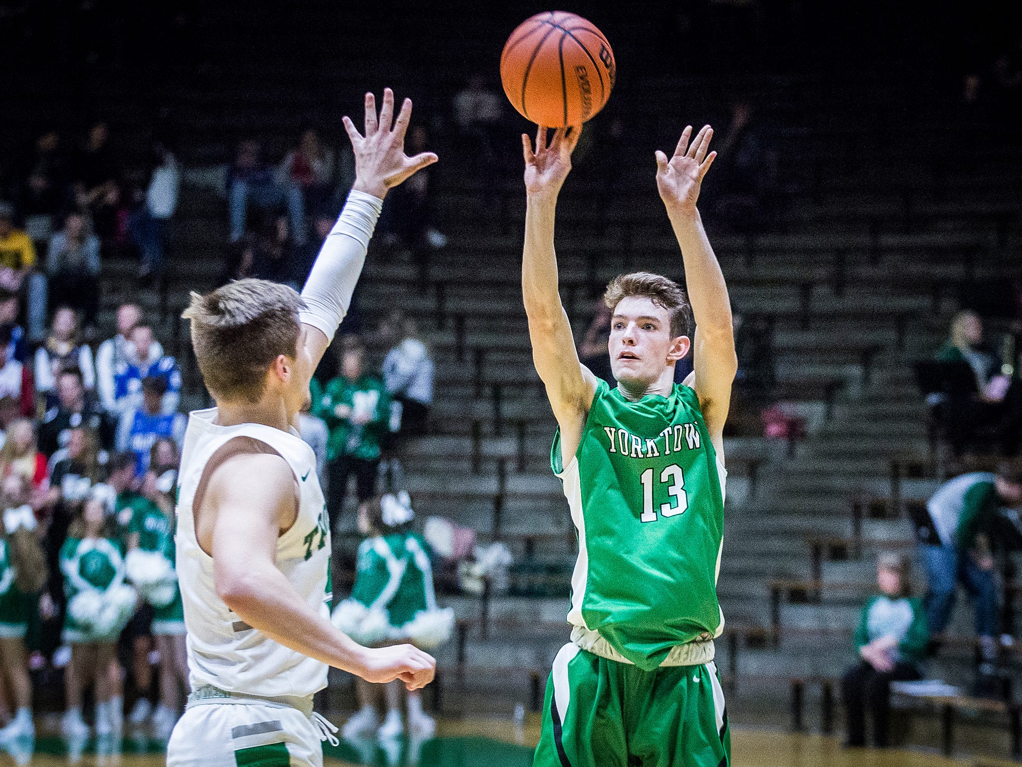 Yorktown's Luke Dunn shoots past New Castle's defense during their game at New Castle High School Friday, Jan. 18, 2019.