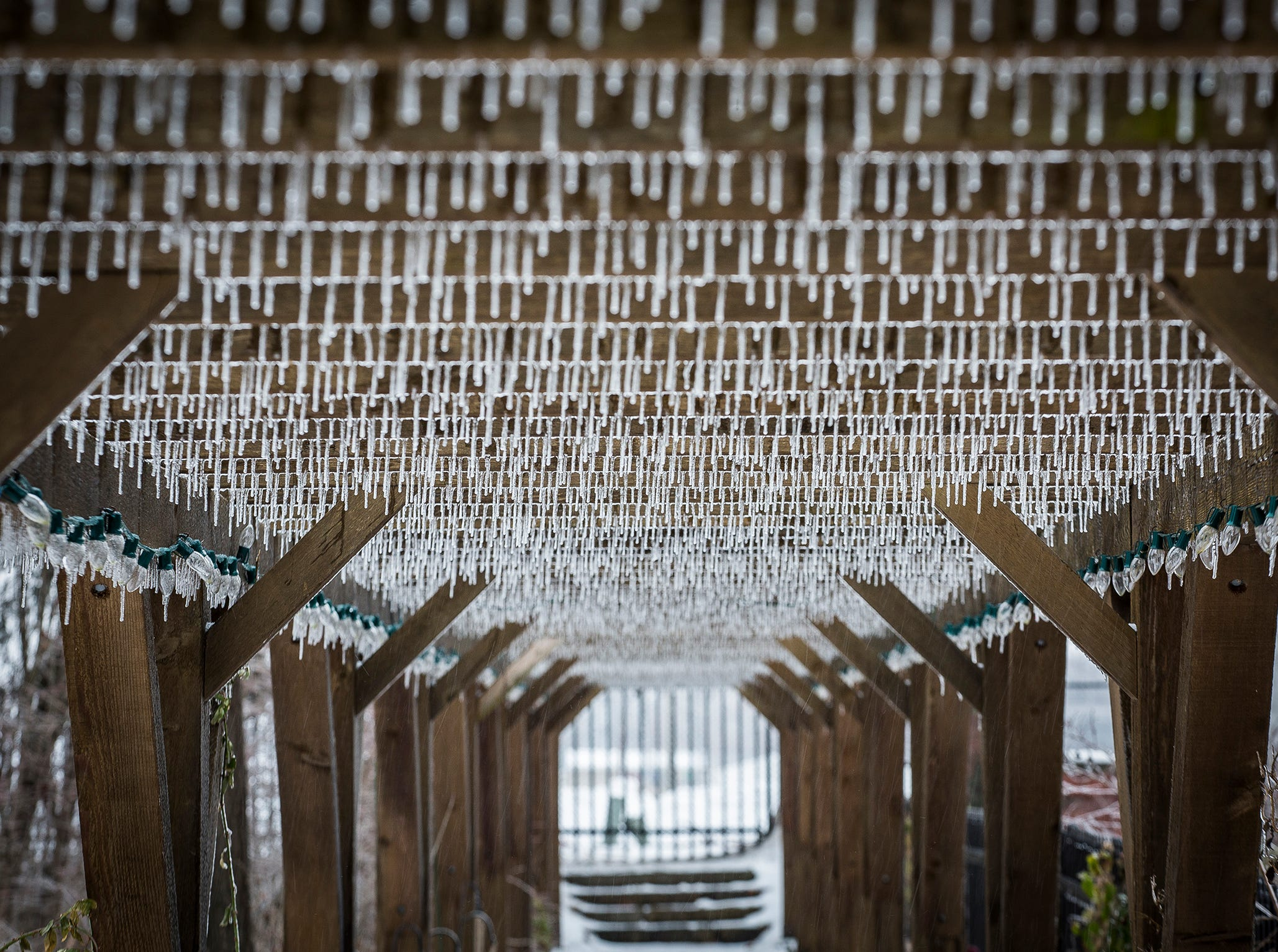 Thousands of icicles form above a walkway at Minnetrista following a downpour of sleet Saturday morning.
