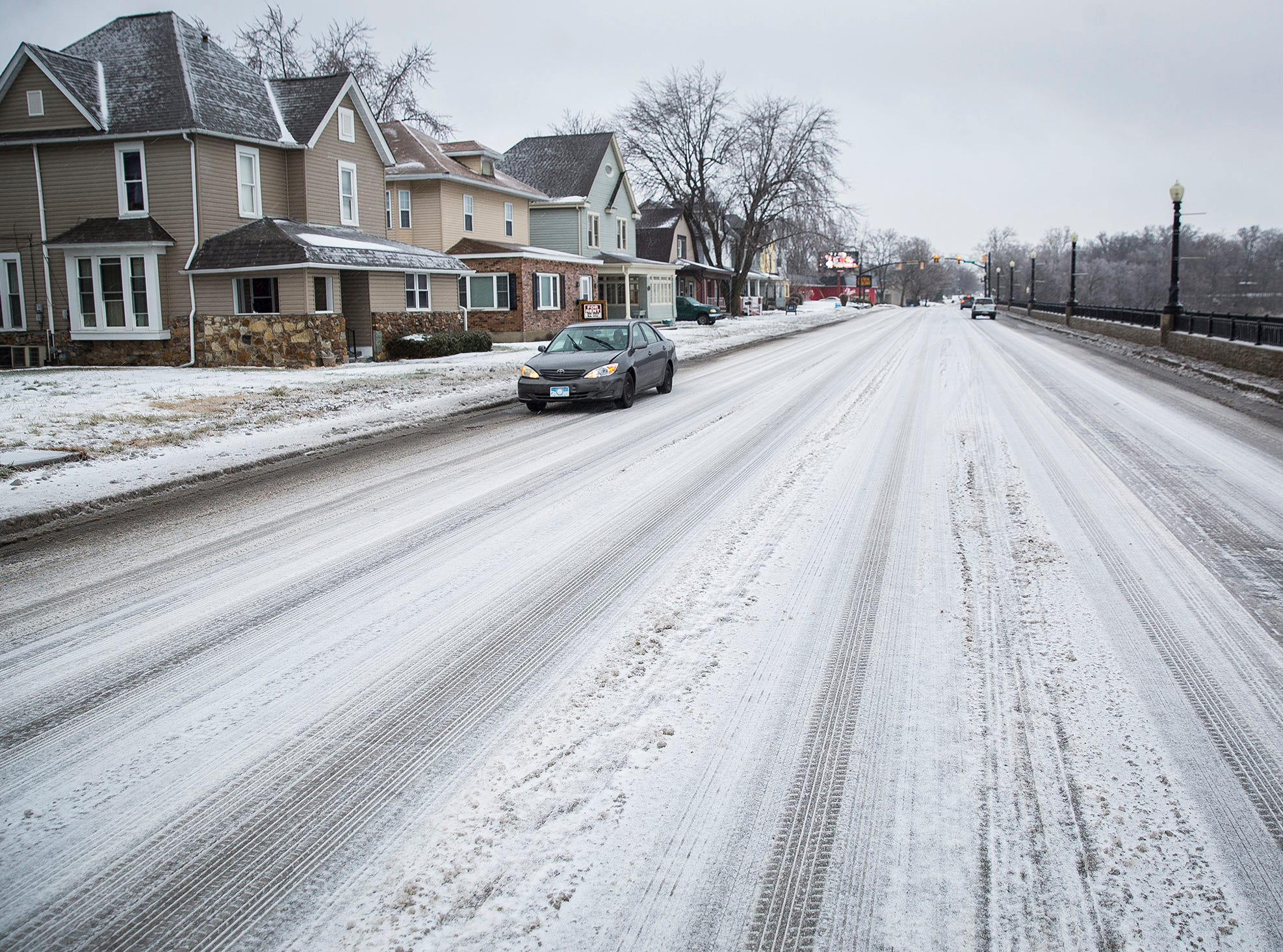 Traffic moves along Wheeling Avenue after sleet covered Delaware County Saturday.
