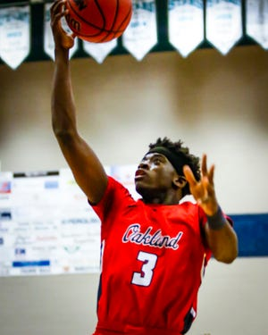 Oakland's De'Arre McDonald goes in for two of his 18 points in Friday's win over Siegel.