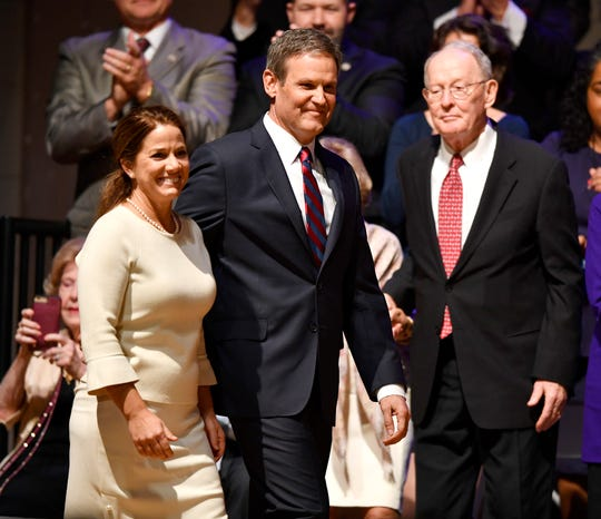 U.S. Sen. Lamar Alexander stands behind Gov. Bill Lee and his wife, Maria, as they arrive on stage for Lee's inauguration as the 50th governor of Tennessee at War Memorial Auditorium in Nashville on Jan. 19.
