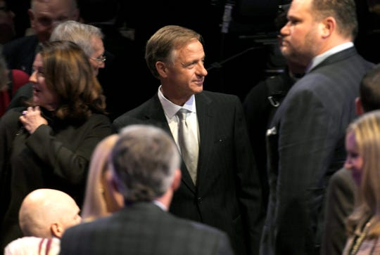 Gov. Bill Haslam mingles in the crowd before the worship service for the Bill Lee inauguration at Grand Ole Opry House in Nashville on Saturday, Jan. 19, 2019.