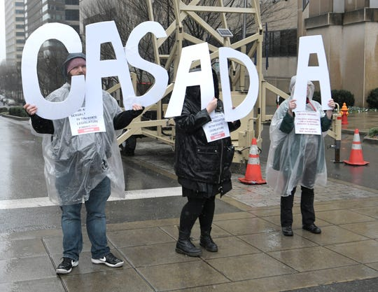 The group Enough is Enough protests against House Speaker Glen Casada outside the inauguration of Bill Lee on Saturday, Jan. 19, 2019.