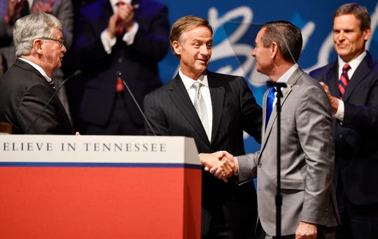 Gov. Bill Haslam shakes hands with Speaker of the House Glen Casada as Lt. Gov. Randy McNally looks on during the inauguration of Bill Lee as the 50th governor of Tennessee at War Memorial Auditorium in Nashville, Tenn., Saturday, Jan. 19, 2019.