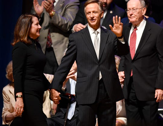 Gov. Bill Haslam waves to the crowd with his wife Crissy during the inauguration of Bill Lee as the 50th governor of Tennessee at War Memorial Auditorium in Nashville, Tenn., Saturday, Jan. 19, 2019.
