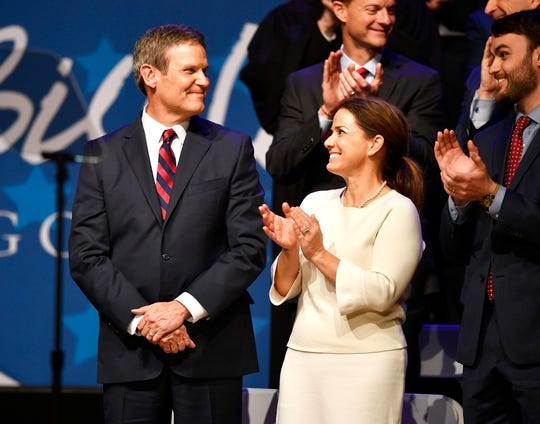Gov. Bill Lee acknowledges the applause after being sworn in as the 50th governor of Tennessee as his wife Maria looks on at War Memorial Auditorium in Nashville, Tenn., Saturday, Jan. 19, 2019.