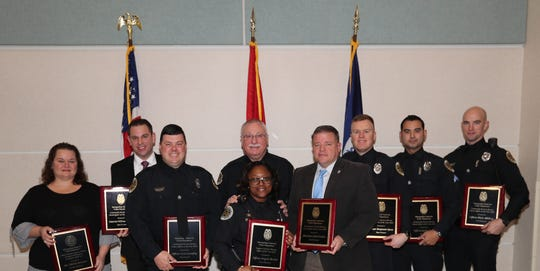 MNPD Employees of the Year for 2018 are congratulated by Chief Anderson.  The eight winners are, from left, Christy Sawyers, William Ashworth, Alex Lampley, Angela Booker, John Grubbs, Benjamin Spees, Justin Coyle, and Blake McKay.
