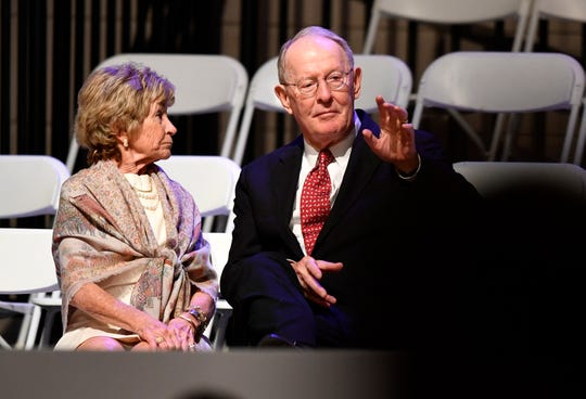 U.S. Sen. Lamar Alexander and his wife, Honey, take their seats before the inauguration of Bill Lee as the 50th governor of Tennessee at War Memorial Auditorium in Nashville on Jan. 19, 2019.