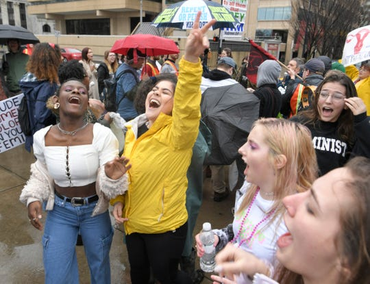 Women dance to the beat of drums at the 2019 Women's Rally at Public Square Park in downtown Nashville Saturday, Jan. 19, 2019.