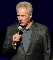 Former NASCAR driver Darrell Waltrip reads scripture at the inaugural worship service at Grand Ole Opry House in Nashville on Saturday, Jan. 19, 2019.